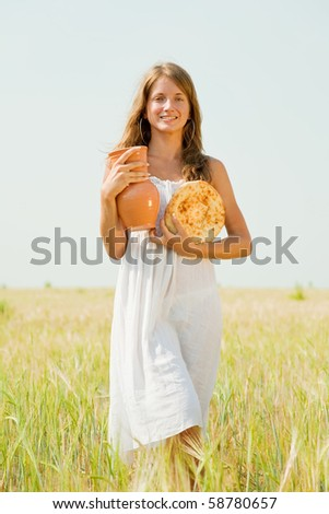Girl with country home-made meal  at cereals field - stock photo