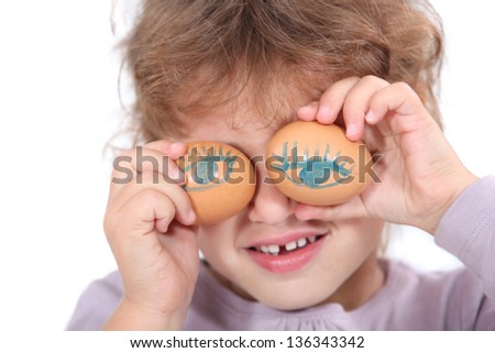 Girl with decorated eggs - stock photo