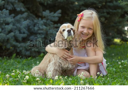 girl with dog looking at the camera  - stock photo