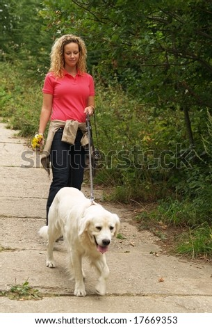 Girl with dog on dog-lead