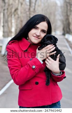 Girl with dog pug - stock photo