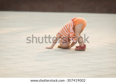 Girl with Down syndrome funny creeps - stock photo