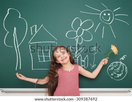 girl with draw village home and other on board - stock photo