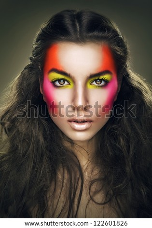 girl with eye shadows on face - stock photo