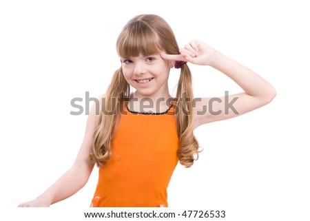 Girl with finger near her head.  Girl in glasses playing the fool. - stock photo