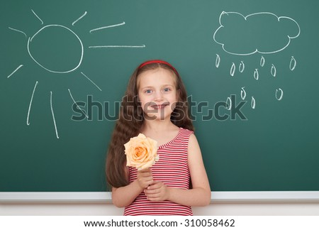 girl with flower draw sun and rainy cloud on board - stock photo