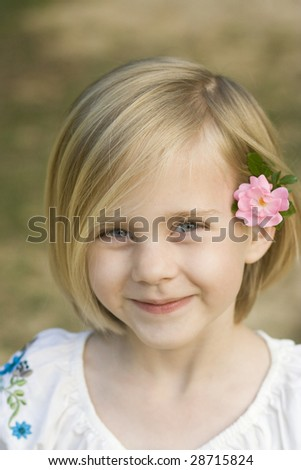 Girl with flower in hair - stock photo