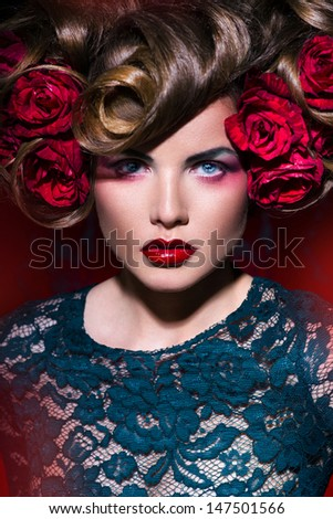 Girl with flowers in her hair  on the red background - stock photo
