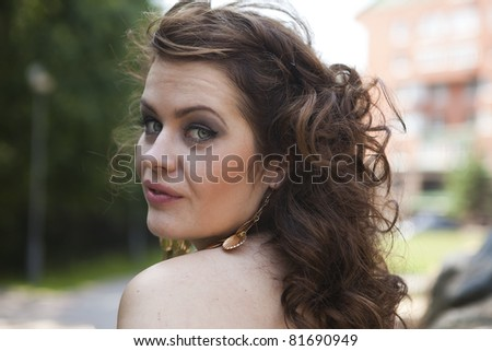 girl with flowing hair on the background of rocks - stock photo