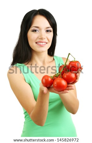 Girl with fresh tomatoes isolated on white