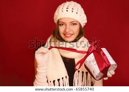 girl with gift on red - stock photo
