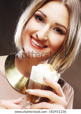 girl with glass of coffee witn cream - stock photo