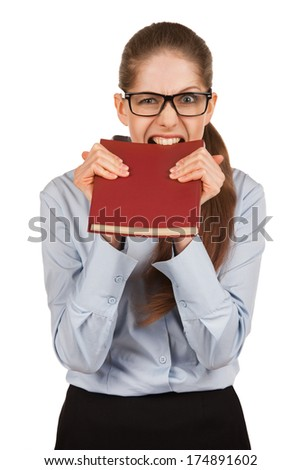 Girl with glasses biting teeth in the book cover - stock photo