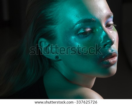 girl with green light on the face