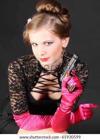 Girl with gun - stock photo