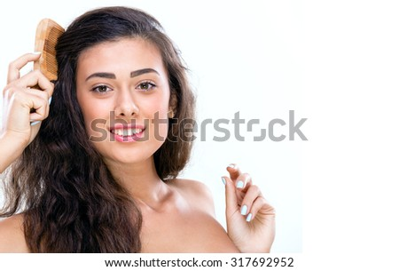 Girl with hair comb