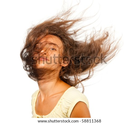 Girl with hair fluttering in the wind - stock photo