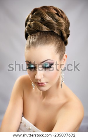 Girl with hairstyle and makeup . Beautiful studio portrait.