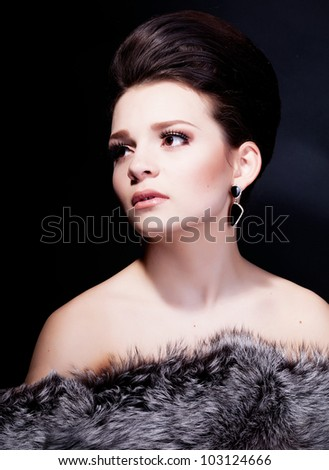 Girl with hairstyle photo in studio - stock photo