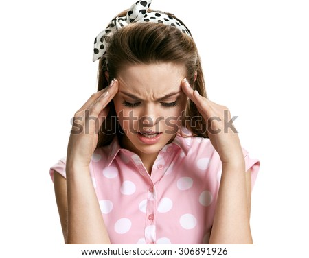Girl with headache stressed / photo of young brunette woman over white background, negative emotions - stock photo