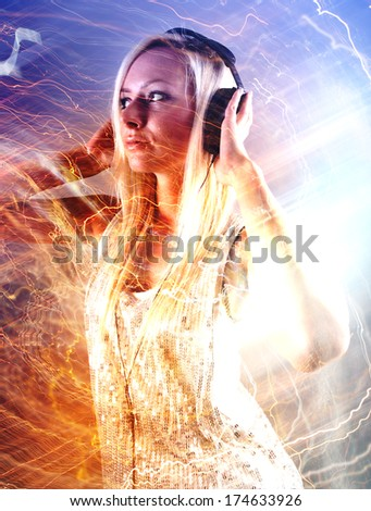 Girl with headphones at the party - stock photo