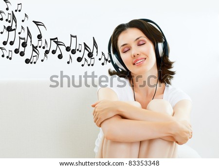 girl with headphones in room - stock photo