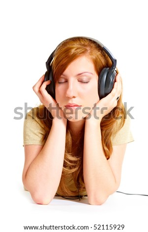 Girl with headphones laying isolated over white background