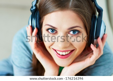 Girl with headphones listening music at home. Female model. - stock photo