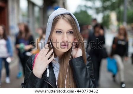 girl with headphones listening to music - stock photo