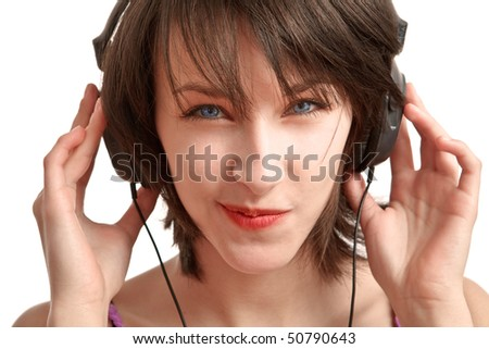 girl with headphones on - listening with pleasure and expression - stock photo