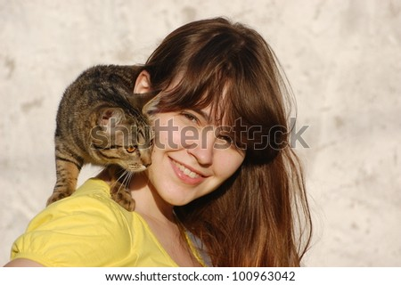 Girl with her cat - stock photo
