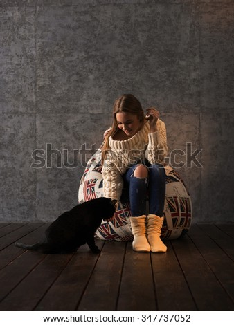 Girl with her Cat on Beanbag at home - stock photo