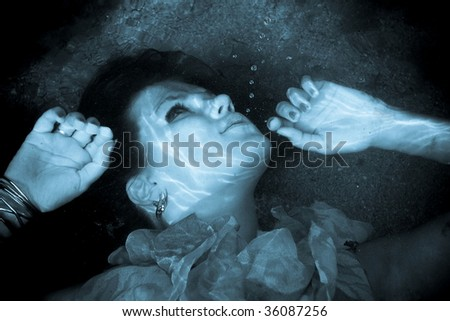 girl with her eyes open is under water - stock photo