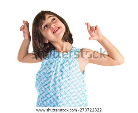 Girl with her fingers crossing   - stock photo
