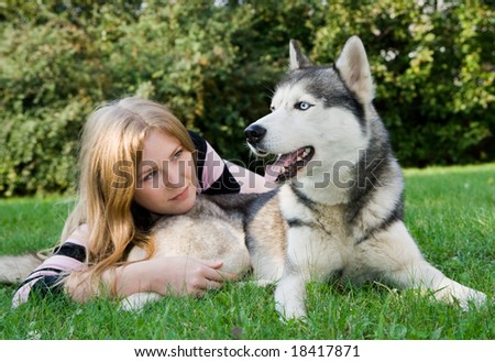 girl with her husky - stock photo