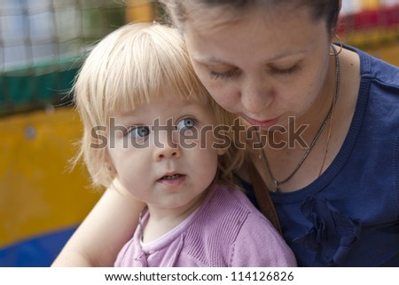 girl with her mother - stock photo