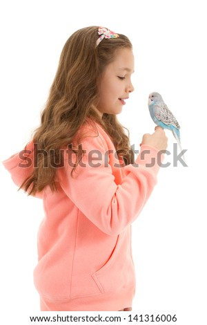 Girl with her pet bird budgerigar. Isolated on white.