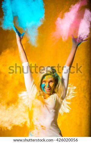 Girl with holi paints - stock photo
