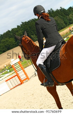 Girl with horse ready to jump - stock photo