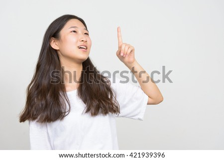 Girl with idea pointing finger up