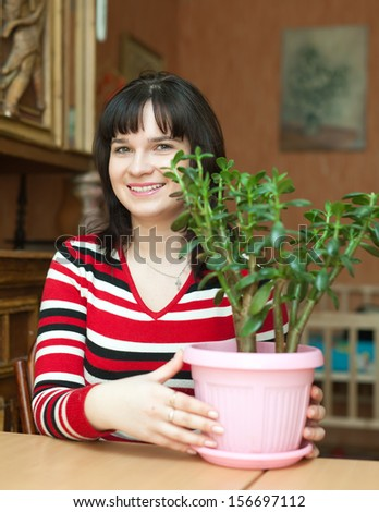 Girl with  jade in pot at her home - stock photo