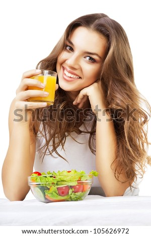girl with juice and salad on white background