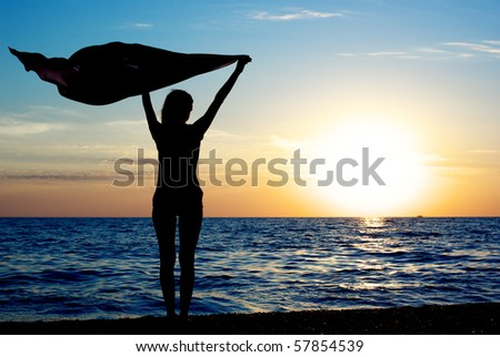 Girl with kerchief on the sunset. Relax scene.