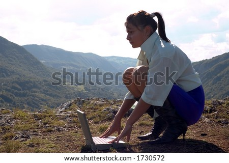 Girl with laptop at nature surroundings
