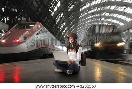 girl with laptop in station - stock photo