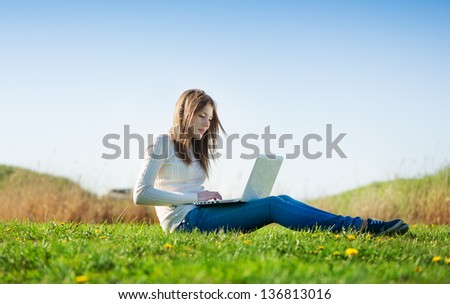 girl with laptop outdoors - stock photo