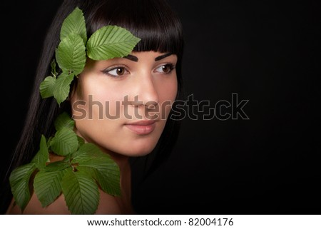 girl with leafs - stock photo