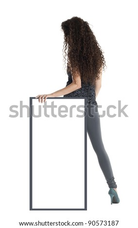 Girl with long curly hair holds the banner