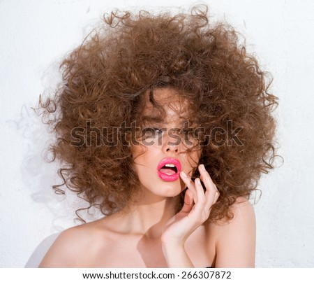 Girl with lush hair and bright lipstick - stock photo