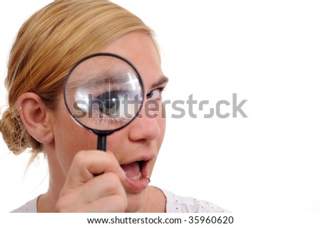 girl with magnifier loupe reviewing  something
